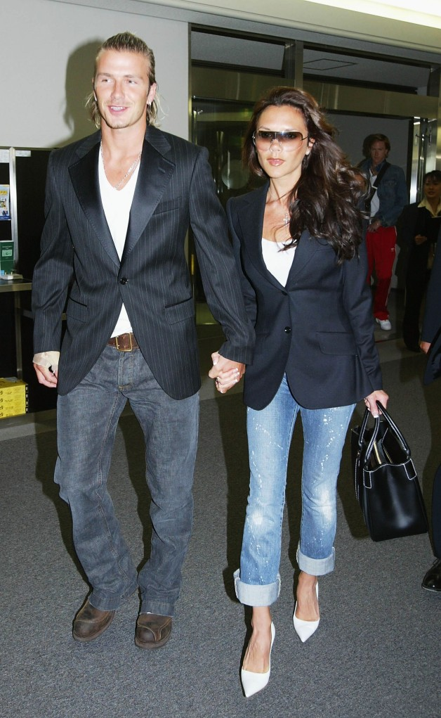 NARITA, JAPAN - JUNE 18: English footballer David Beckham and his wife Victoria arrive at New Tokyo International Airport on June 18, 2003 in Narita, Chiba-Prefecture, Japan. The England mid - fielder Beckham 28, has ended weeks of speculation by agreeing personal terms on a four year contract from Manchester United to Spanish football giants Real Madrid, worth ?24.5m. (Photo by Koichi Kamoshida/Getty Images).