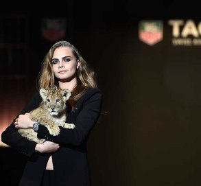 Model Cara Delevingne walks the runway with a lion as she joins TAG Heuer as Brand Ambassador to launch the new 2015 campaign at Palais des Beaux-Arts on January 23, 2015 in Paris, France.